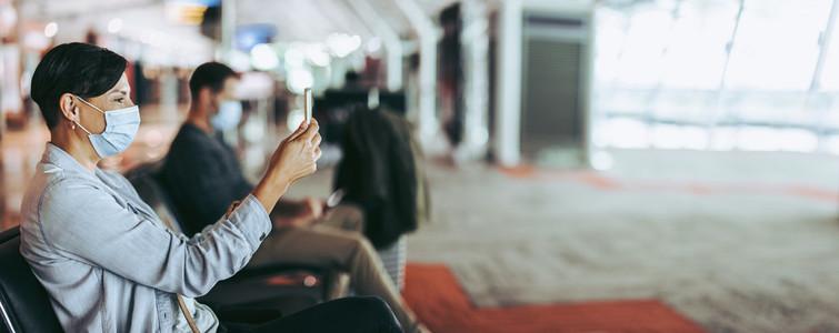Traveler video calling while waiting at airport