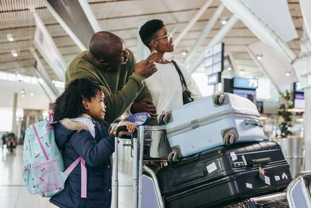 Tourist family waiting at international airport
