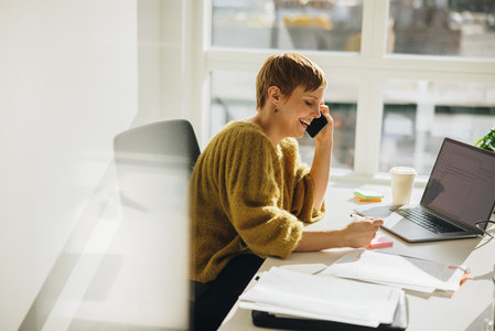 Female executive working in office