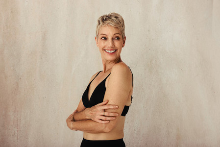 Carefree mature woman embracing her aging body