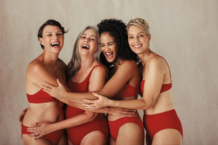 Body positive women of all ages embracing their natural bodies