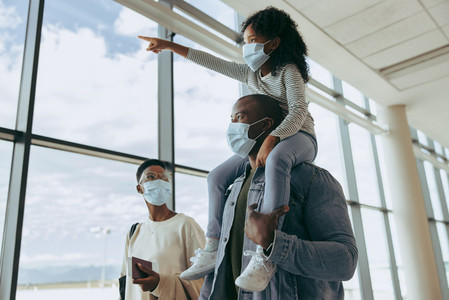 African family at airport in pandemic