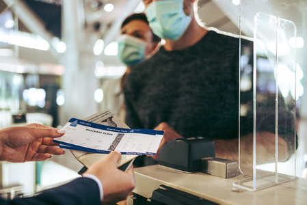 Airlines staff working at check in counter during pandemic