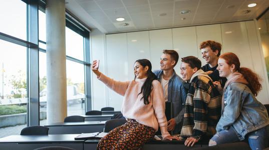 Classmates taking selfie in classroom