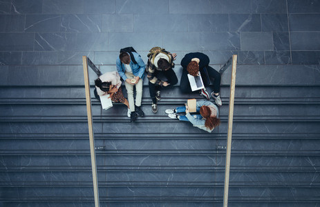 Students sitting in college campus