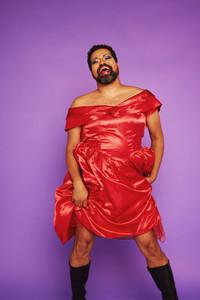 Gay man wearing makeup and red dress