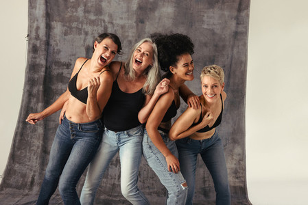 Women of different ages having fun in jeans