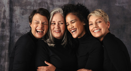Cheerful women of different ages in a studio
