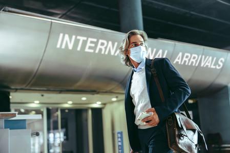 Man leaving arrivals terminal