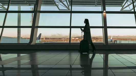 Silhouette of woman traveler