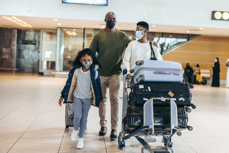 Family in face masks at airport