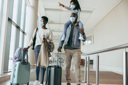 Family at airport during pandemic