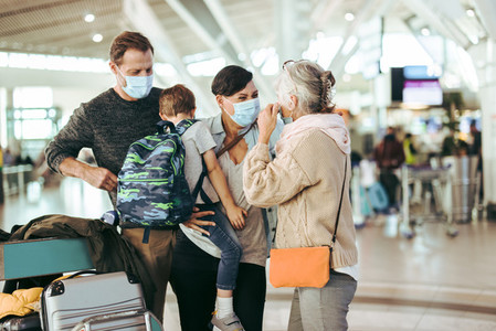 Family reunion at airport after pandemic lockdown