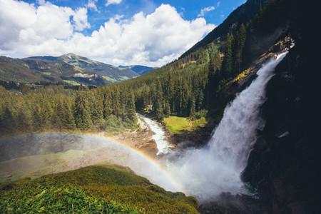 beautiful waterfall in the alpine mountains