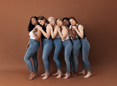 Full length of six women stands one after another with closed eyes  Side view of diverse females embracing each other