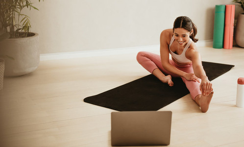 Female fitness instructor conducting online class