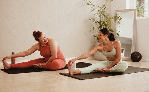 Women doing stretching workout at gym
