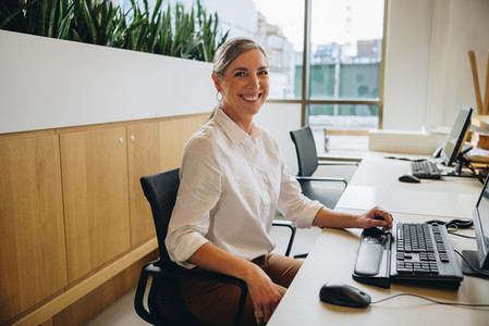 Friendly receptionist working in office