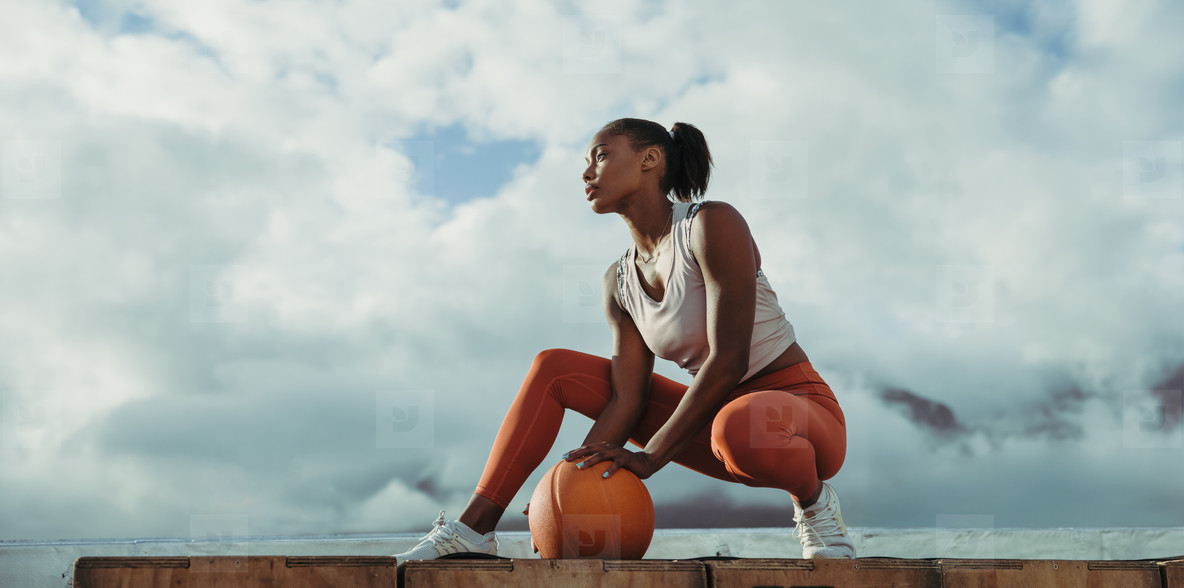 Woman relaxing after exercise on rooftop
