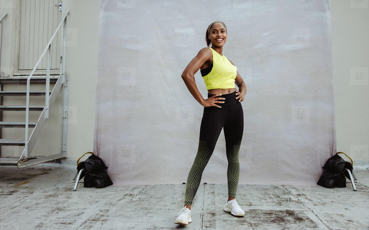Portrait of a fit african woman in sportswear