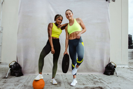 Female athletes posing after workout session