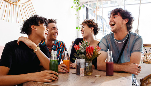 Fun friends laughing together in a restaurant