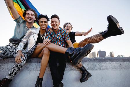 Four LGBTQ people celebrating pride together