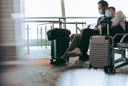 Couple during covid 19 outbreak waiting for delayed flight