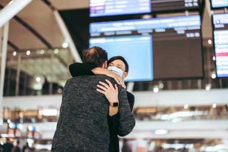 Couple meet after long separation in pandemic at airport