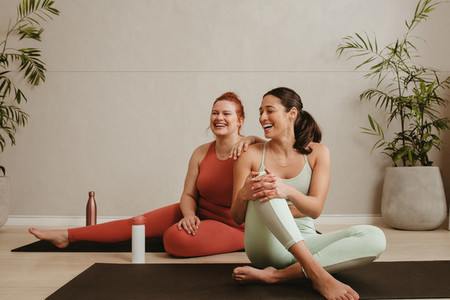 Two woman happy after completing a workout