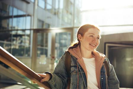 Confident female student in college