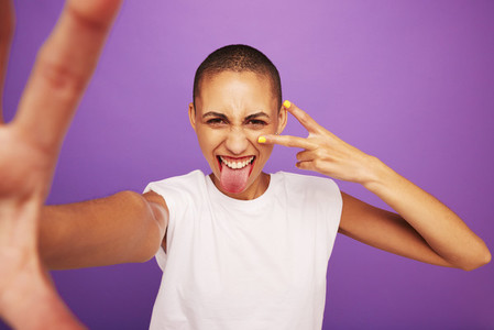 Expressive woman posing on purple background
