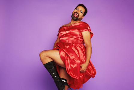 Androgynous male in red shiny dress