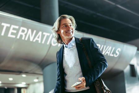 Happy business traveler