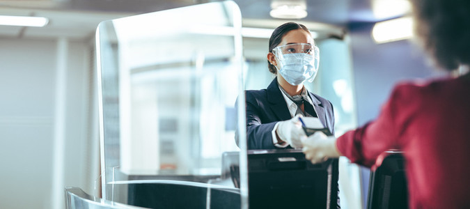 Flight attendant wearing mask