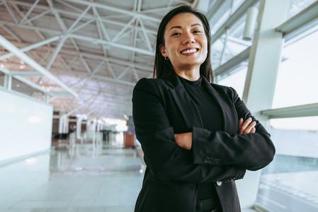 Smiling woman at airport