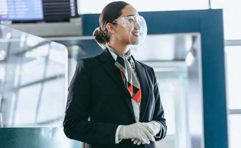 Airlines staff with face shield working at airport
