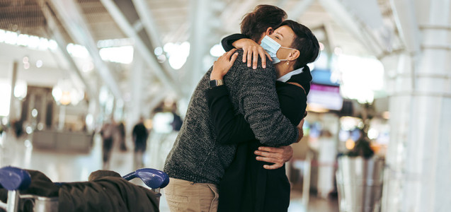 Woman welcoming her husband arriving from abroad