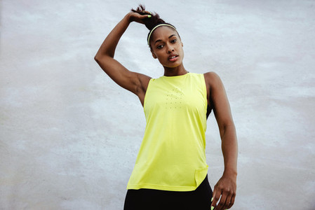 African fitness woman looking at camera
