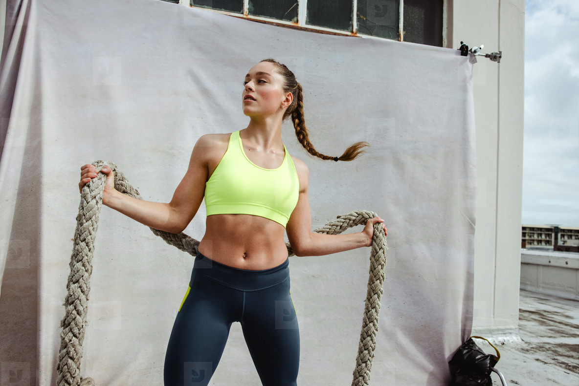 Fitness woman with battle rope