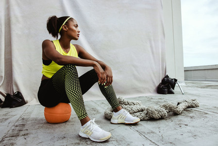 African woman taking break from cross training session