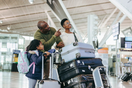 African family at airport standing with luggage