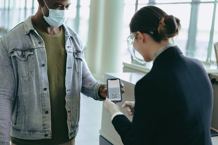 Airlines attendant checking medical pass during pandemic