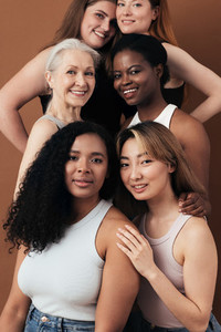 Portrait of six women of different ages looking at camera in studio