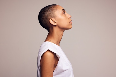Androgynous woman with shaved head