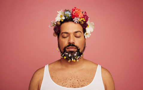 Gay man with flowers on head and beard