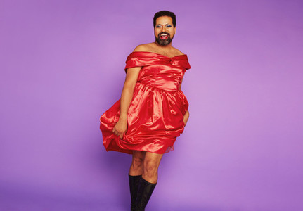 Queer person tanding in female dress