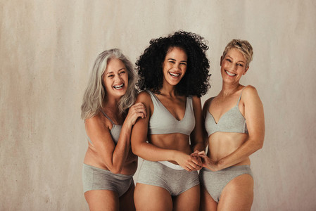 Women embracing their matural bodies together