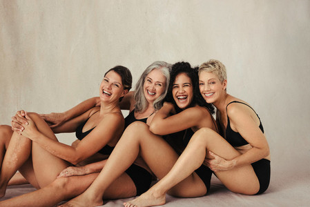 Cropped shot of four confident women embracing their natural bod