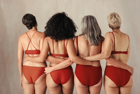 Shot of four anonymous women embracing their natural bodies